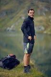 Hiker near the mountain lake Royalty Free Stock Photography