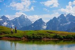 Hiker near the mountain lake. In Svaneti, Georgia. Caucasus mountains Royalty Free Stock Photos