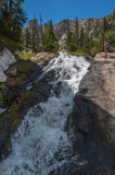 Hiker near the Waterfall Colorado Rockies Stock Images