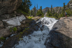 Hiker near the Waterfall Colorado Rockies Royalty Free Stock Photo