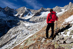 Hiker observing a high mountain panorama Stock Images