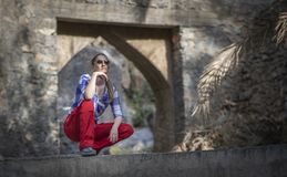 Hiker in an old omani garden stock images