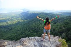 Hiker open arms at cliff edge on mountain top. Successful woman hiker open arms at cliff edge on mountain top Royalty Free Stock Photo