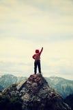 Hiker open arms on mountain peak. Cheering woman hiker open arms on mountain peak Stock Photography