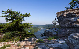 Hiker overlook Harpers Ferry landscape. Senior male hiker overlooking the shenandoah and potomac rivers by the town of Harpers Ferry Stock Images