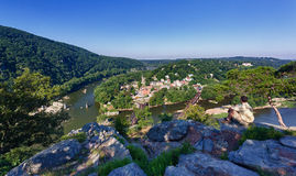Hiker overlook Harpers Ferry landscape. Senior male hiker overlooking the shenandoah and potomac rivers by the town of Harpers Ferry Stock Image