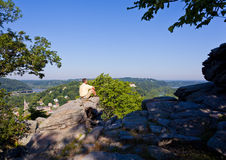Hiker overlook Harpers Ferry landscape. Senior male hiker overlooking the shenandoah and potomac rivers by the town of Harpers Ferry Royalty Free Stock Photos