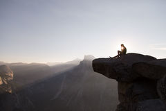 Hiker on overlook at sunset Royalty Free Stock Photos