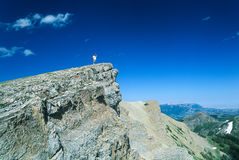 Hiker Overlooking Eastern Front Rocky Mountains Stock Photo