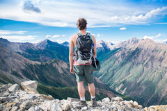 Hiker  Overlooking A Mountain Summit  Royalty Free Stock Images