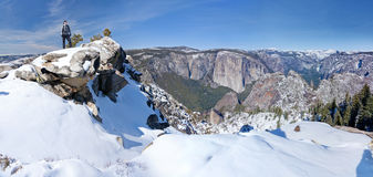 Hiker overlooking Yosemite Valley. A Snowshoe hiker overlooking Yosemite National Park in winter Stock Photo