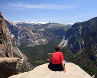 Hiker overlooking Yosemite view Stock Image
