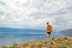 Hiker with pack overlooking Adriatic Sea, Rab Island, Croatia stock images
