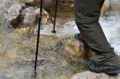 Hiker pass mountain river. Closeup Stock Photos
