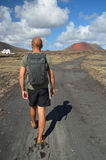 Hiker on a path. Montana del Fuego. Alone hiker on a volcanic path. Canary Islands, Lanzarote, Montana del Fuego Stock Image
