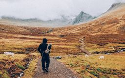 Hiker on path in mountains Royalty Free Stock Images