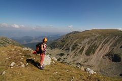 Hiker pause on top of the mountain Stock Images