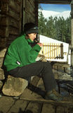 Hiker Pauses for a Snack Stock Images