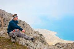 Hiker on a peak Royalty Free Stock Photo