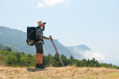 Hiker on a peak Royalty Free Stock Photography