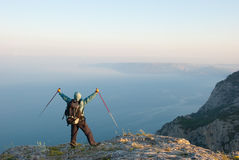 Hiker on a peak Stock Photography