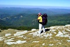 Hiker photographer in mountains Stock Photos
