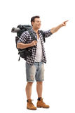Hiker pointing with his finger isolated on white background Royalty Free Stock Photos