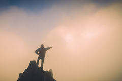 Hiker points to the sunrise. Instagram stylization Royalty Free Stock Photography