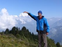 Hiker on Poon Hill, Dhaulagiri range, Nepal. Happy hiker on Poon Hill, Dhaulagiri range on the backround - one of the most visited Himalayan view points in Nepal royalty free stock photography