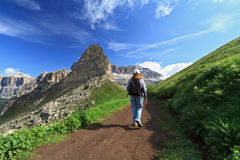 Hiker in Pordoi pass Royalty Free Stock Images