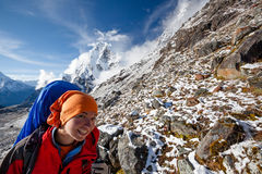Hiker posing at camera on the trek in Himalayas, Nepal royalty free stock photography