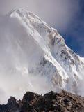 Hiker posing at camera on the trek in Himalayas, Nepal Royalty Free Stock Photo