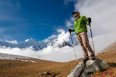 Hiker posing at camera on the trek in Himalayas, Nepal Stock Photos