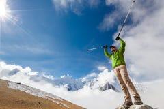 Hiker posing at camera on the trek in Himalayas, Nepal Royalty Free Stock Images