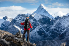 Hiker posing at camera on the trek in Himalayas, Nepal royalty free stock photo