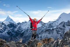 Hiker posing at camera on the trek in Himalayas, Nepal Stock Photography