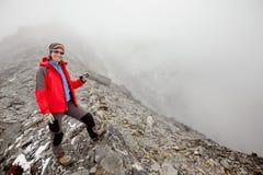Hiker posing at camera on the trek in Himalayas, Nepal Royalty Free Stock Image