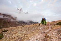 Hiker posing at camera on the trek in Himalayas, Nepal Royalty Free Stock Photos