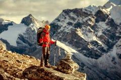 Hiker posing at camera on the trek in Himalayas Royalty Free Stock Image