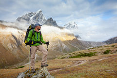 Hiker posing at camera on the trek in Himalayas, Nepal Royalty Free Stock Images