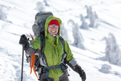 Hiker posing at camera in winter mountains Stock Photos