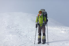 Hiker posing at camera in winter mountains Royalty Free Stock Photography
