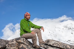 Hiker posing in Himalayas. In front of big mountains Stock Photos