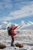 Hiker posing in Himalayas Stock Images