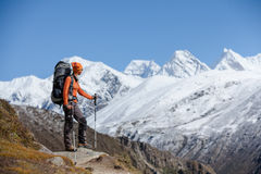 Hiker posing in Himalayas Stock Photo