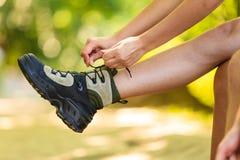 Hiker preparing their footwear. Royalty Free Stock Photos
