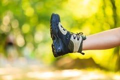Hiker preparing their footwear. Royalty Free Stock Images