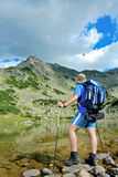Hiker at Prevalski lake in national park Pirin Royalty Free Stock Photo