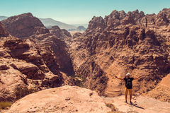 Hiker with raised hand impressed amazing view. Meditation nature. Achievement concept. Ecotourism. Copy space. Rocky mountain land Stock Image