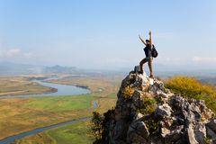 Hiker raises his arms up and screaming with delight. Autumn day royalty free stock images